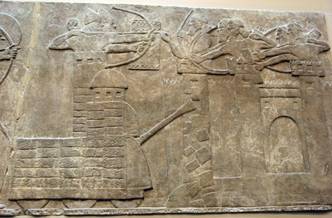 Assyrian attack on a town with a battering ram (9th century BC)