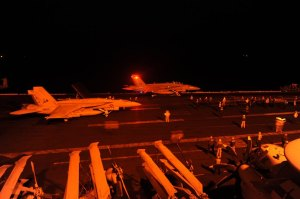 U.S. jet fighters prepare to launch from the aircraft carrier USS George H.W. Bush in the Arabian Sea to conduct strike missions against Islamic State targets, September 2014.