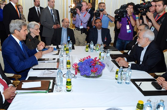 U.S. Secretary of State John Kerry and Iranian Foreign Minister Mohammad Javad Zarif in Vienna, Austria, on July 14, 2014, sitting for a bilateral meeting focused on Iran's nuclear program. [State Department photo/ Public Domain]